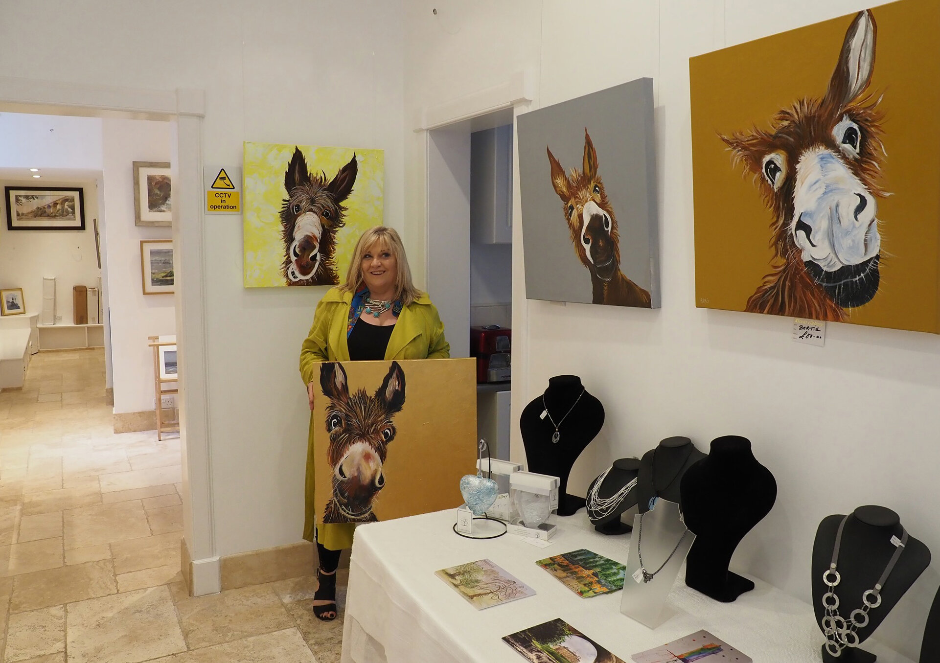 Margaret Bitici with some of her donkey family